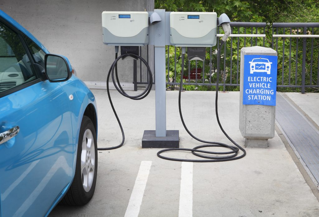 This image shows the charging process of the electric vehicle in the commercial charging station.